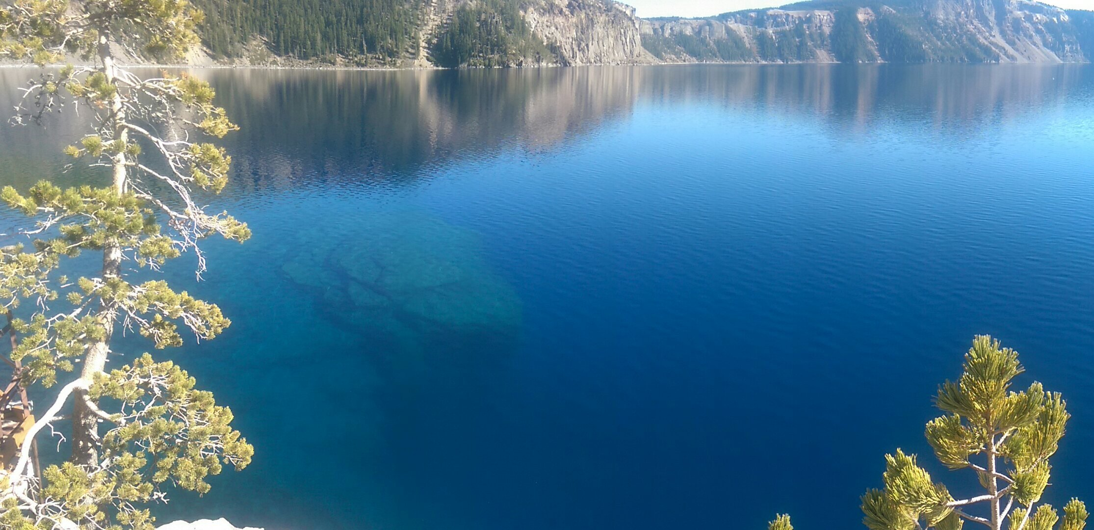 Download A Different View Of Crater Lakewhere The Shoreline Drops Off To A Depth Of 1943 Feet