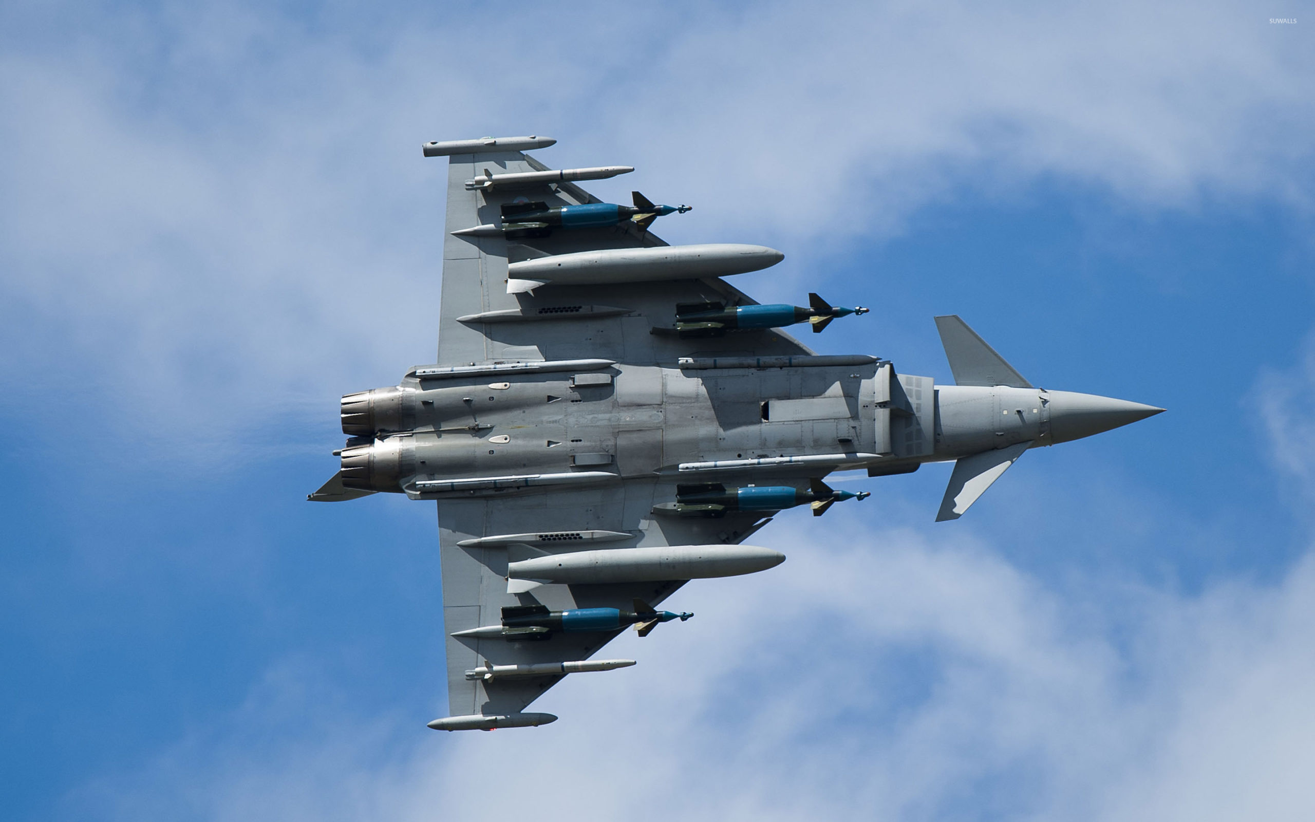 BAE Systems Test pilot Mark Bowman flies Eurofighter Typhoon with a full war load. 4xAMRAAM, 2ASRAAM, 2 1000Litre drop tanks and 4 LGB Bombs at RAF Fairford.