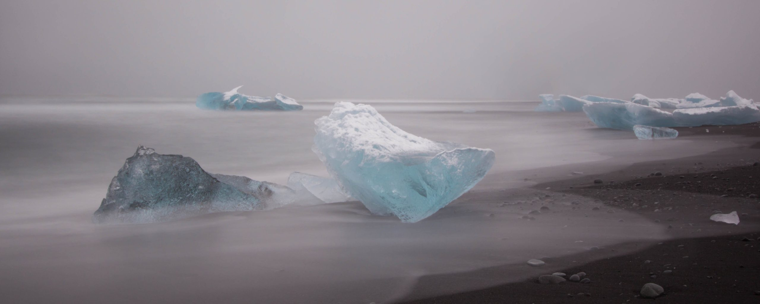 Download Iceland Glacial Icebergs On A Black Volcanic Sand Beach And A Dusting Of Snow Stujophoto  Wallpaper