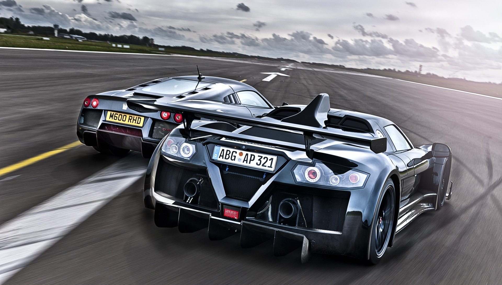 racing cars on track wallpaper