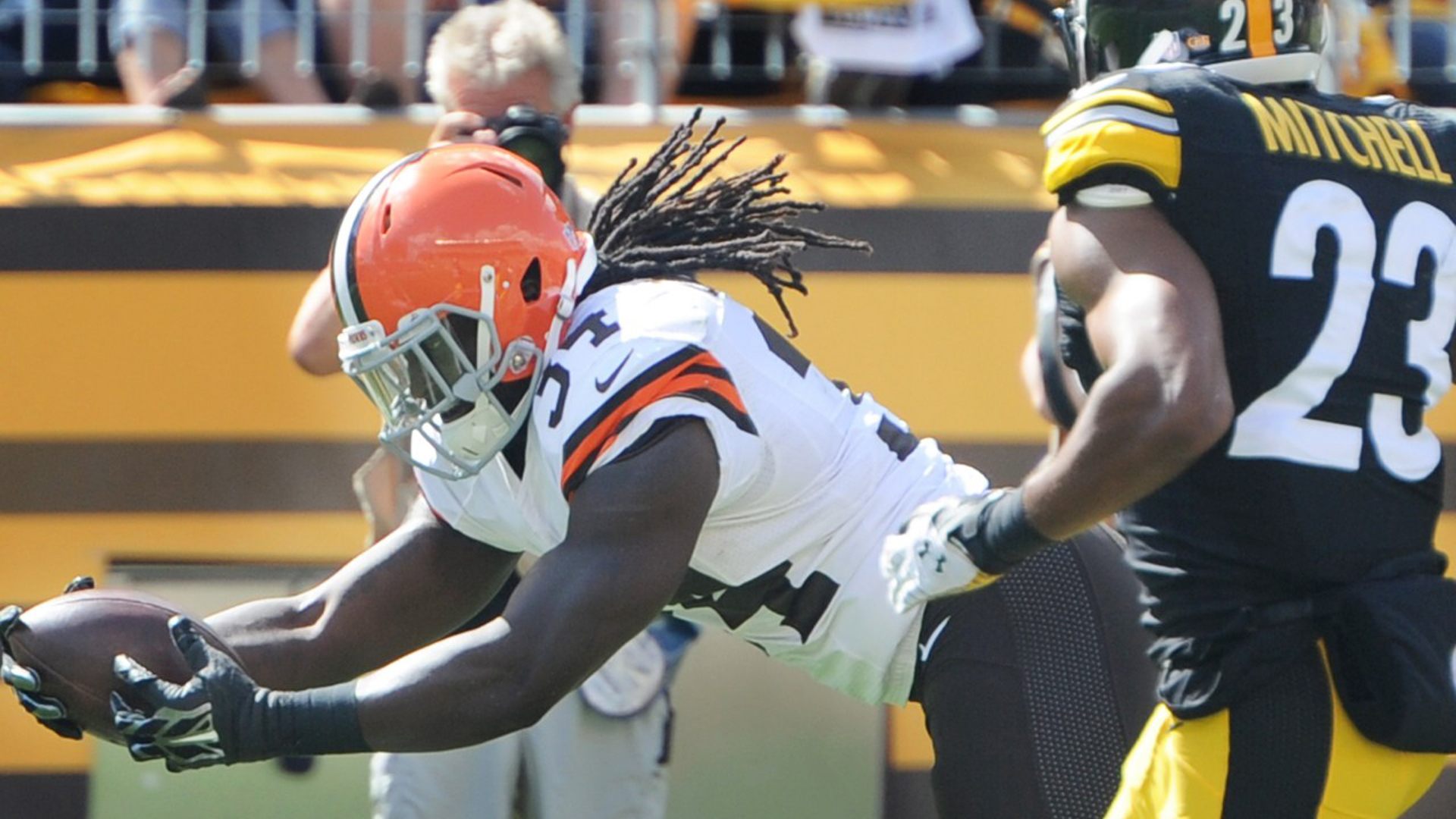 Download American Football Cleveland Browns Black Man With White Dress And Brown Ball Hd Cleveland Browns