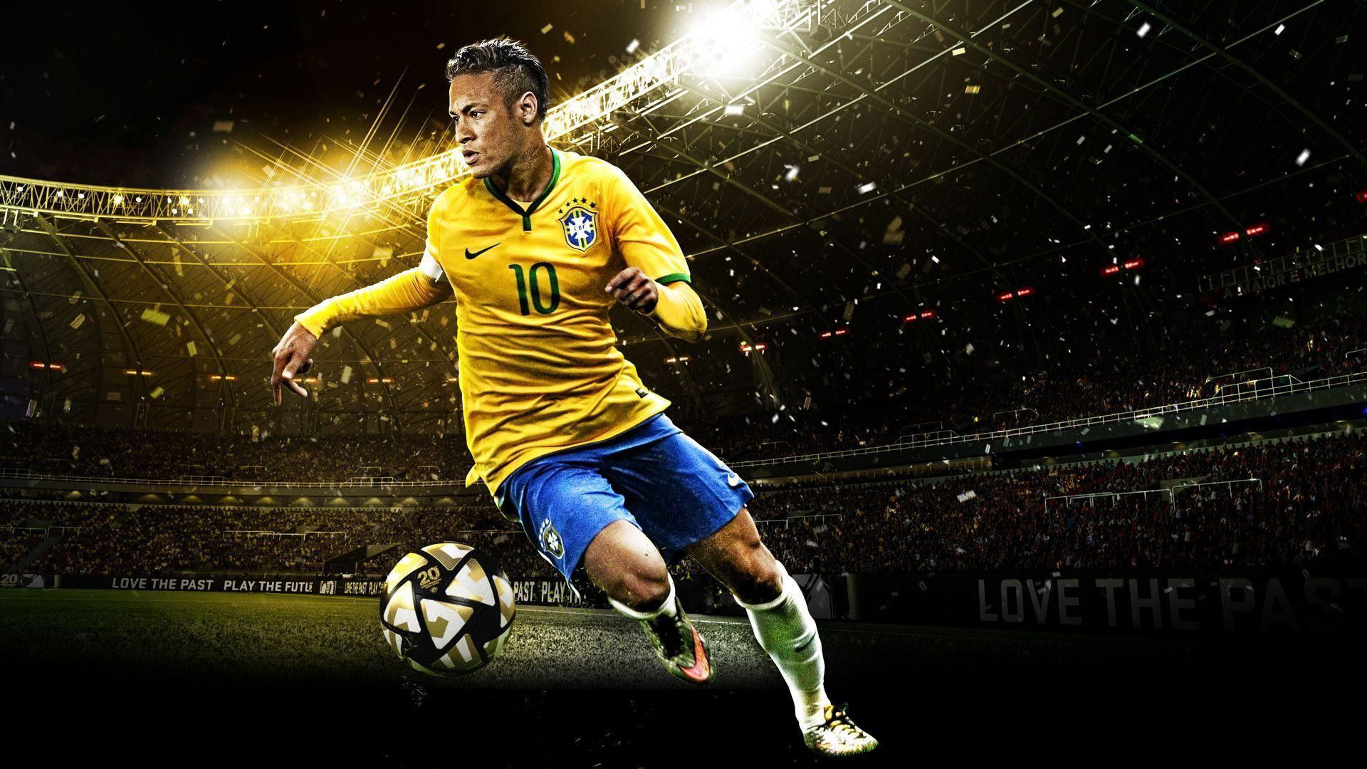 Download Football Player Is Wearing Yellow Blue Sports Dress In Audience Background Hd Football