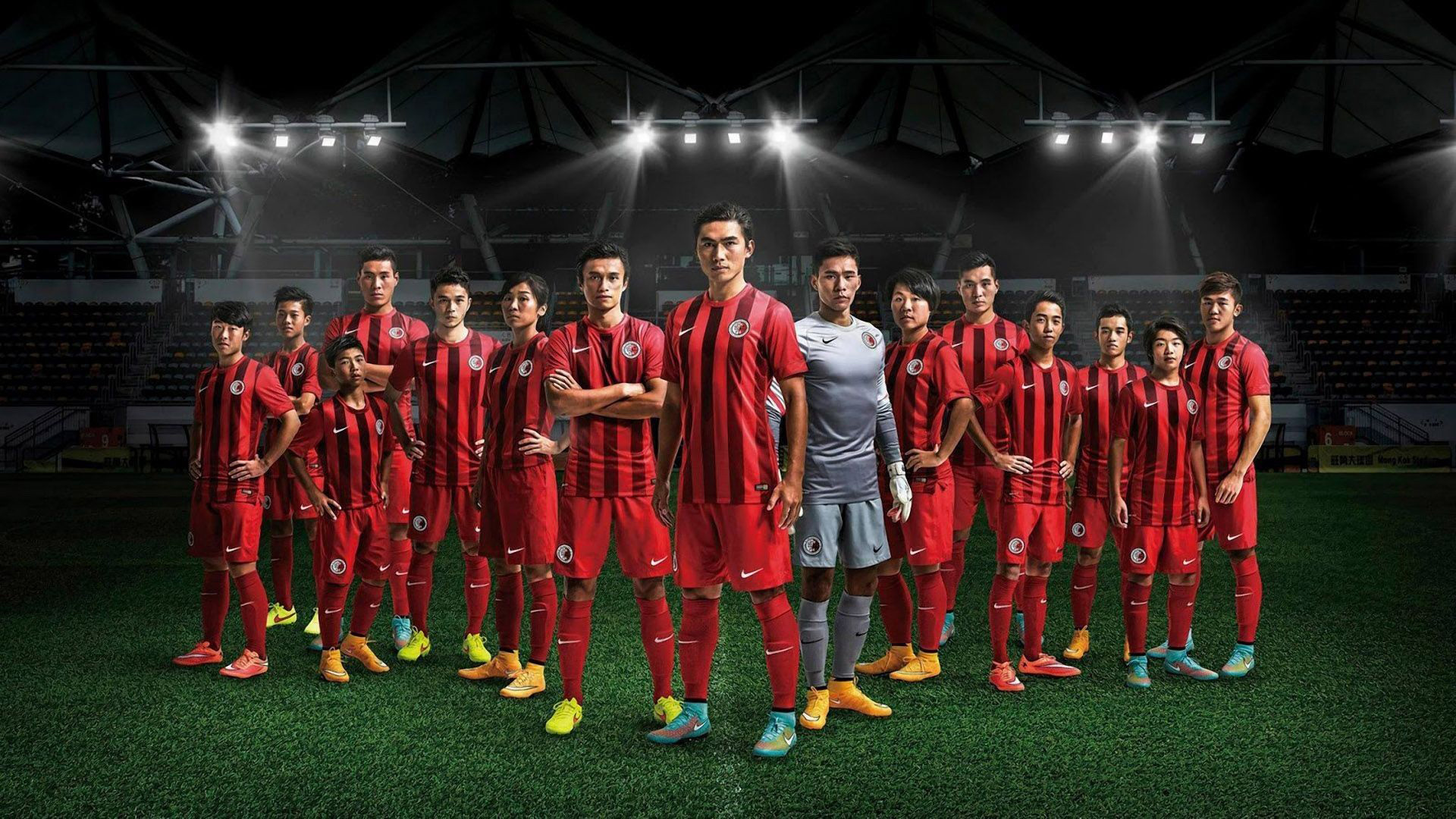 Download Football Players Are Standing On Green Grass Wearing Red Black Sports Dress Hd Football