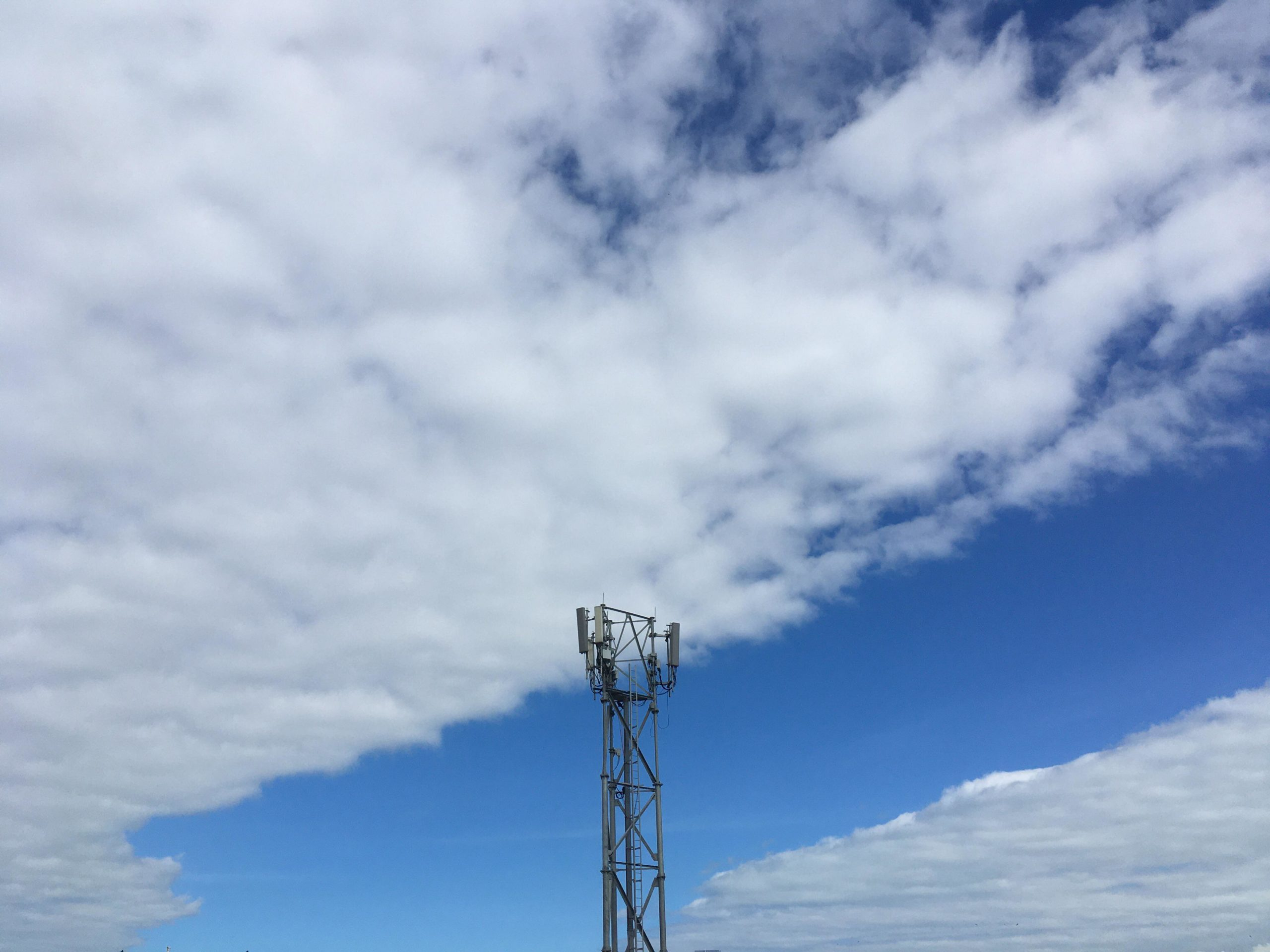 Download Itap Of Clouds And Signal Tower Wallpaper