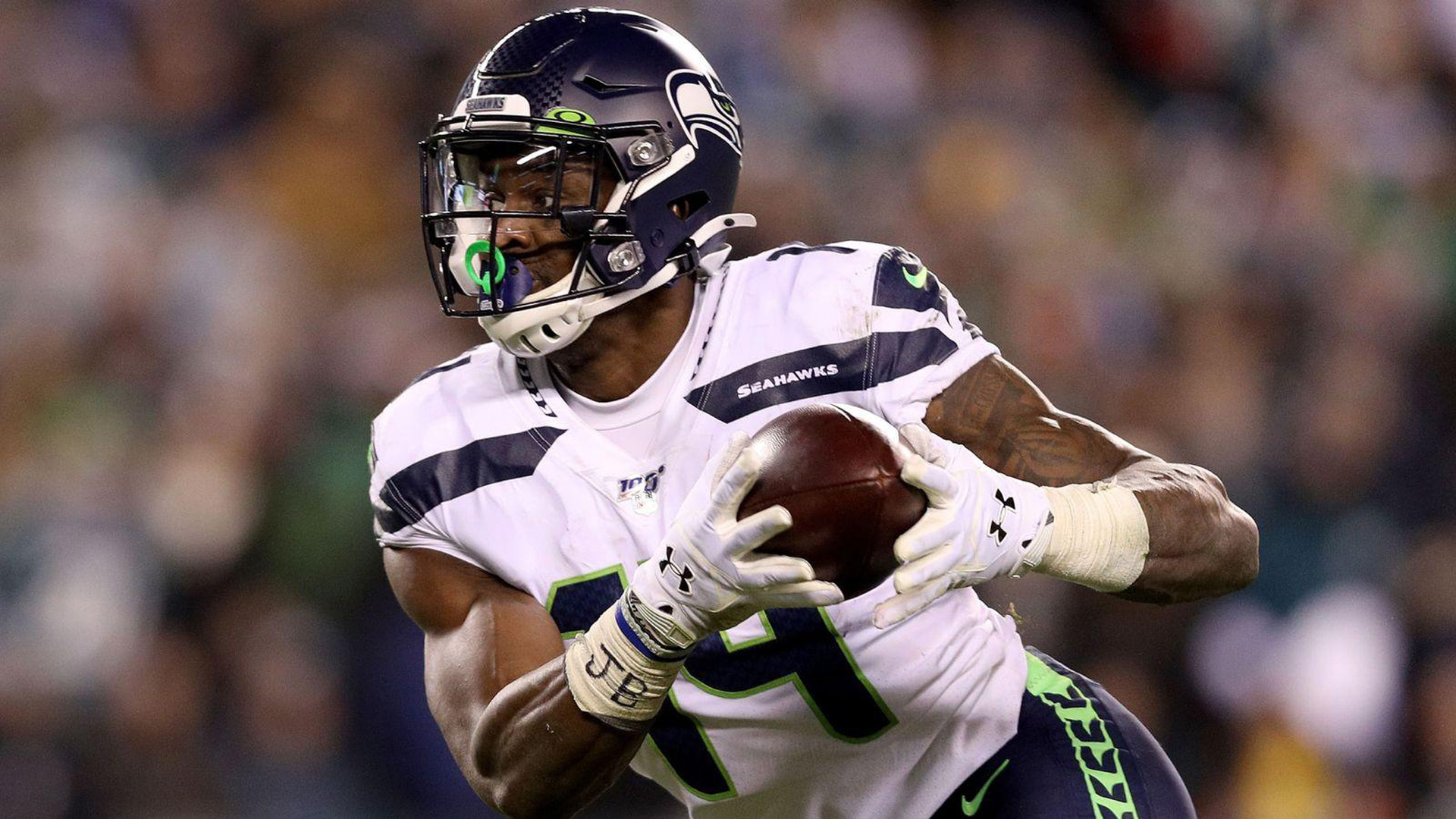 Download Metcalf With Football Is Wearing White Seahawks Sports Dress In Blur Background Hd Dk Metcalf