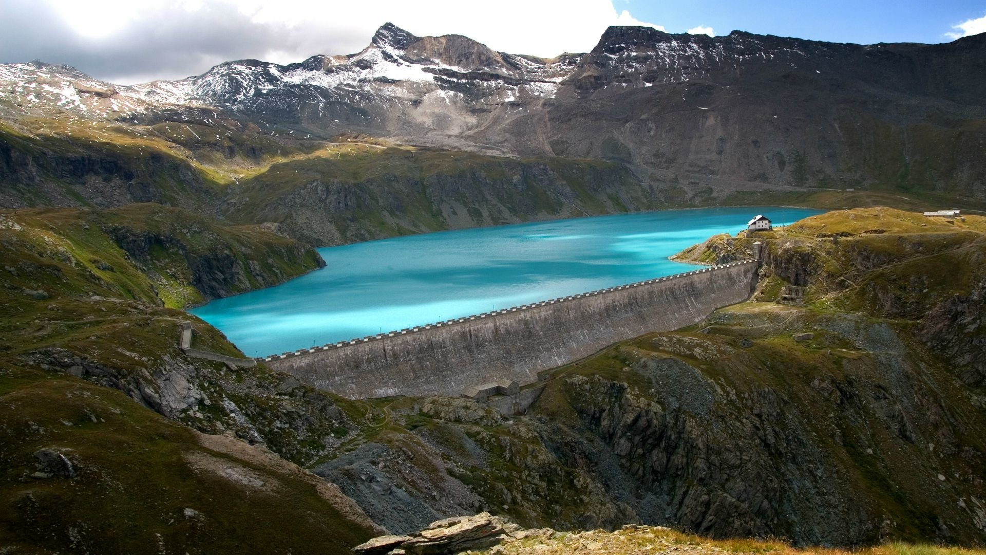 Download Natural Water Reservoir In Mountains