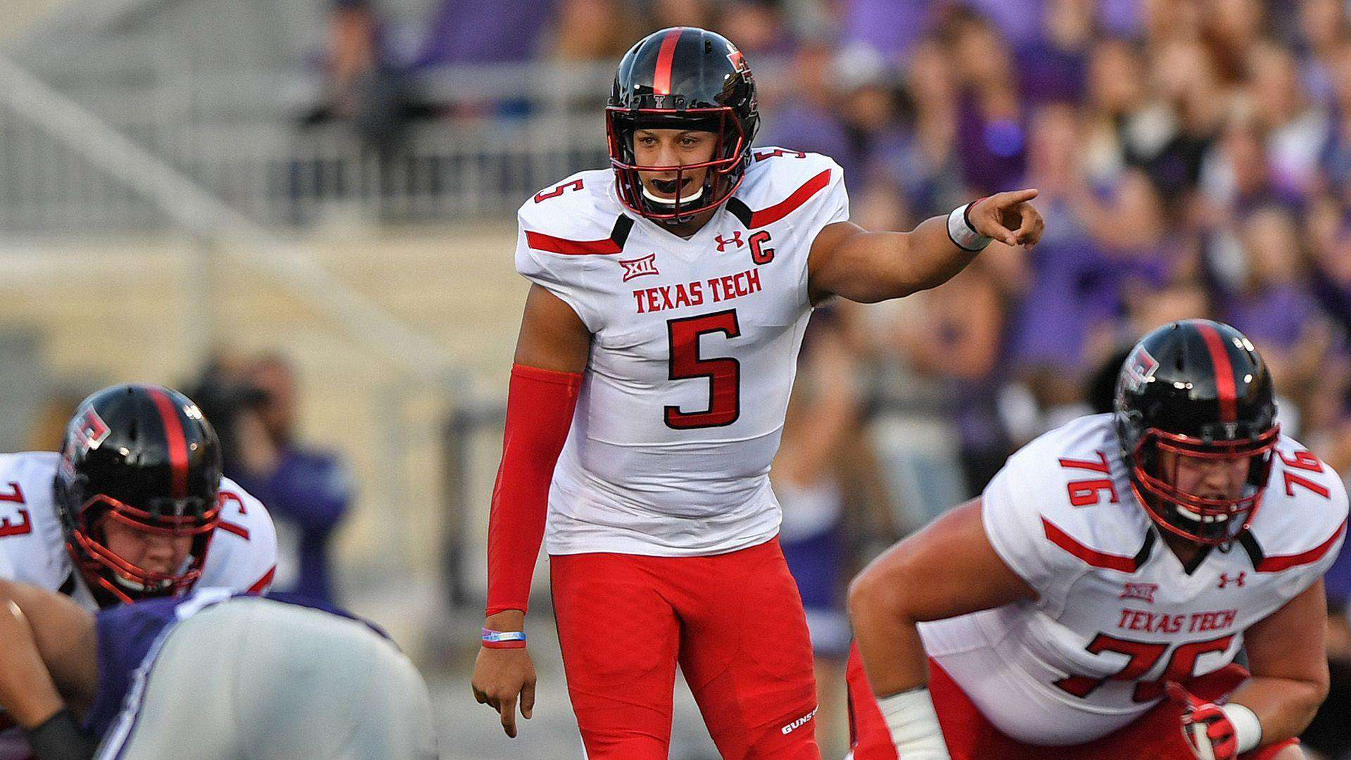 Download Patrick Mahomes Is Showing Hand Straight Wearing White And Red Sports Dress And Black Helmet Hd Sports Hd