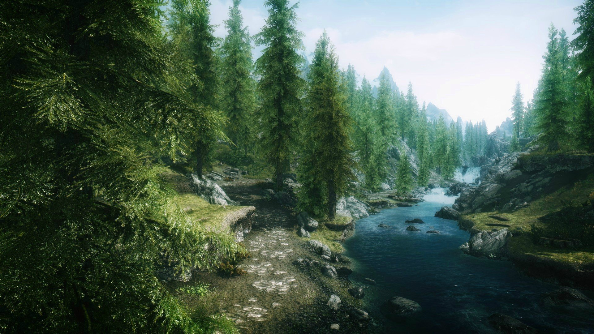 Download River Making Way Line Between Trees And Mountains  Wallpaper