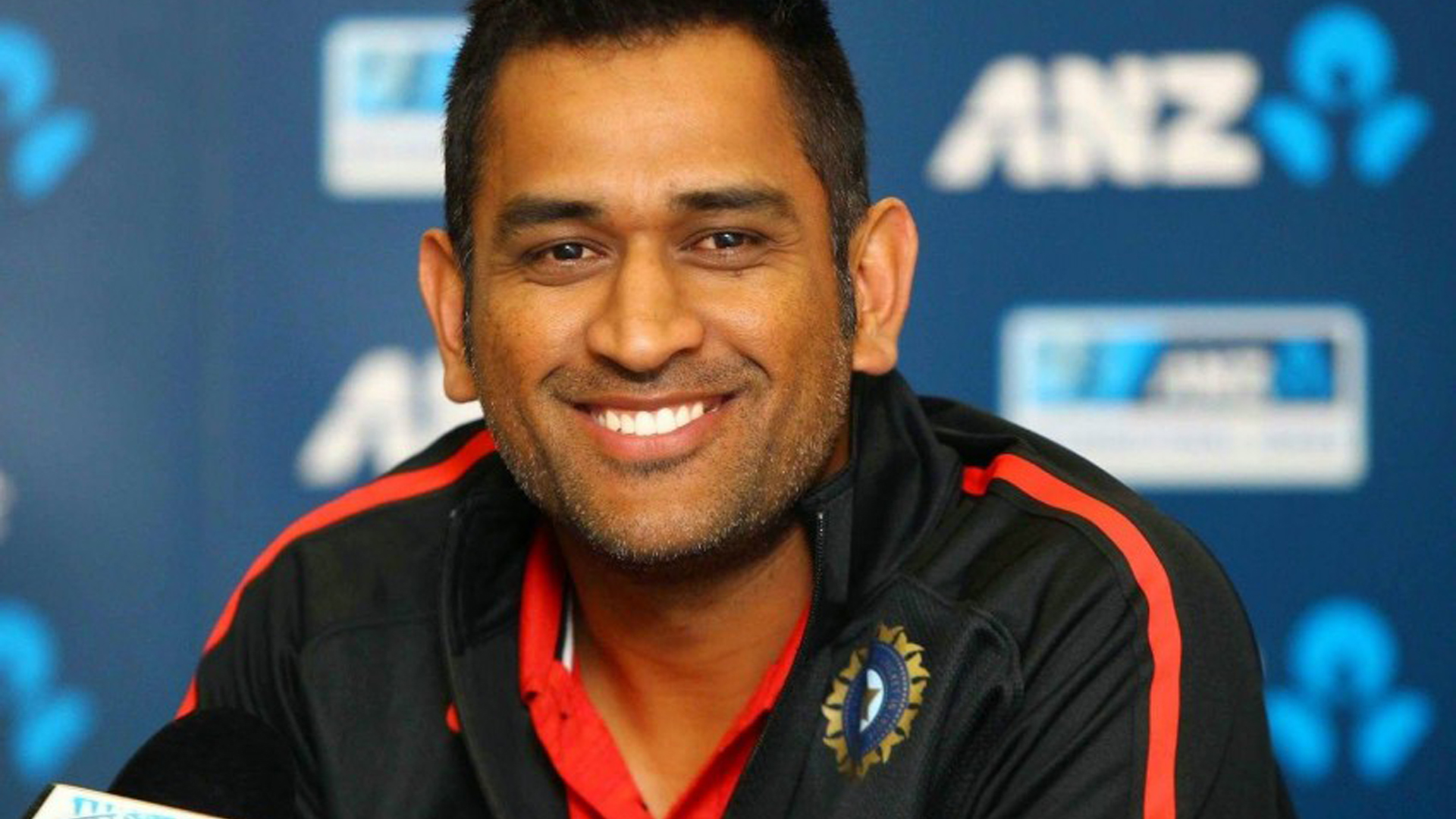 Download Smiley Ms Dhoni Is Wearing Red Black Sports Dress Hd Dhoni