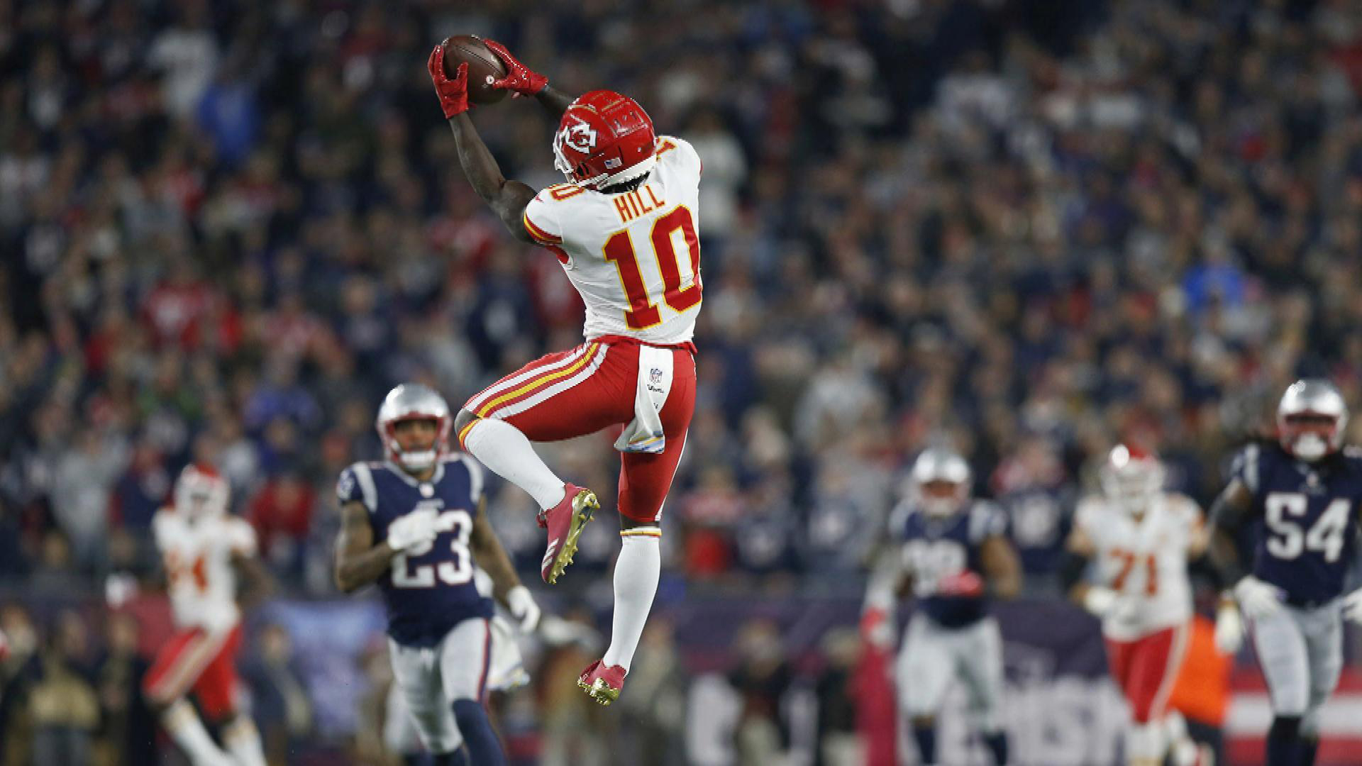 Download Tyreek Hill Is Jumping High To Catch A Ball Wearing White Red Sports Dress Hd Tyreek Hill