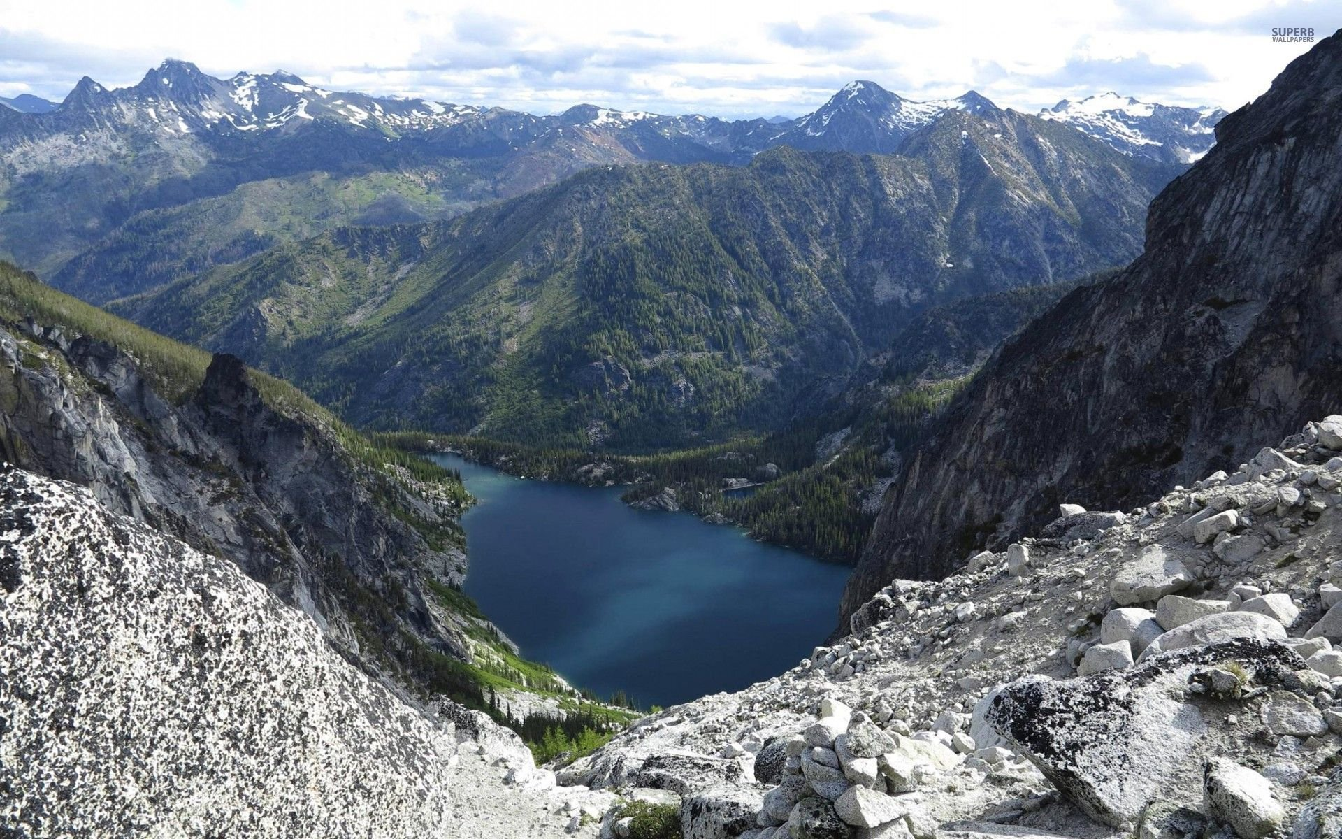 Download View Of The Lake From The Rocky Mountains Wallpaper