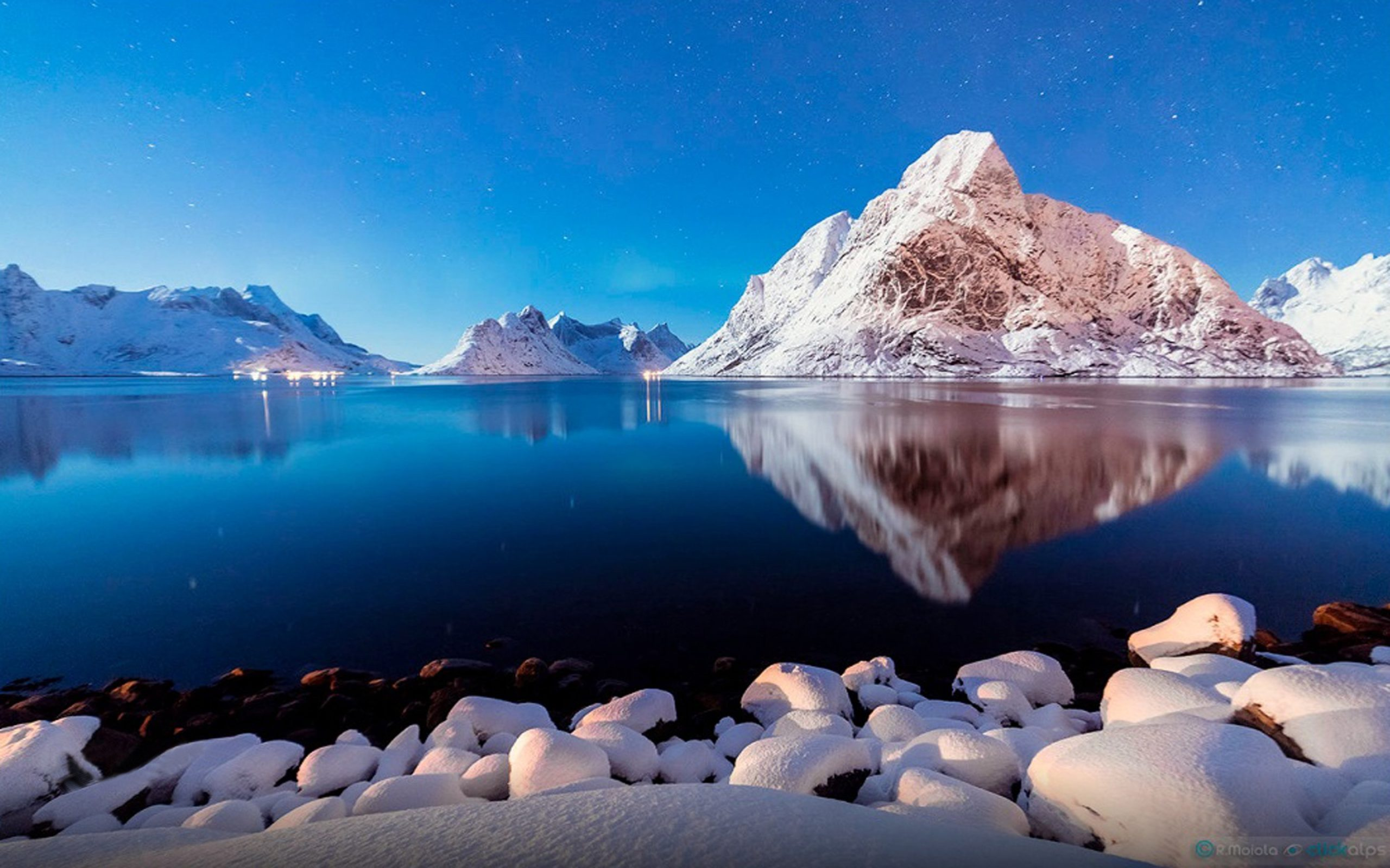Download Winter Peaceful Lake Shore Stones Snow Mountains Blue Reflection In Water